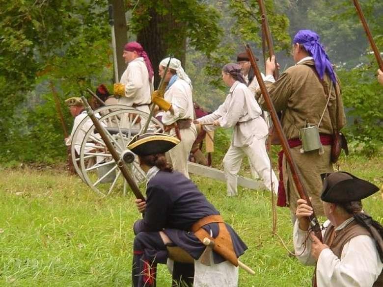 Costumed reenactors portraying a battle scene
