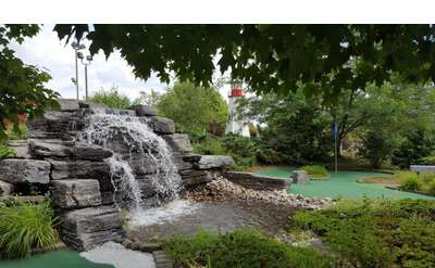 water feature at a mini golf course with a green visible to the right side