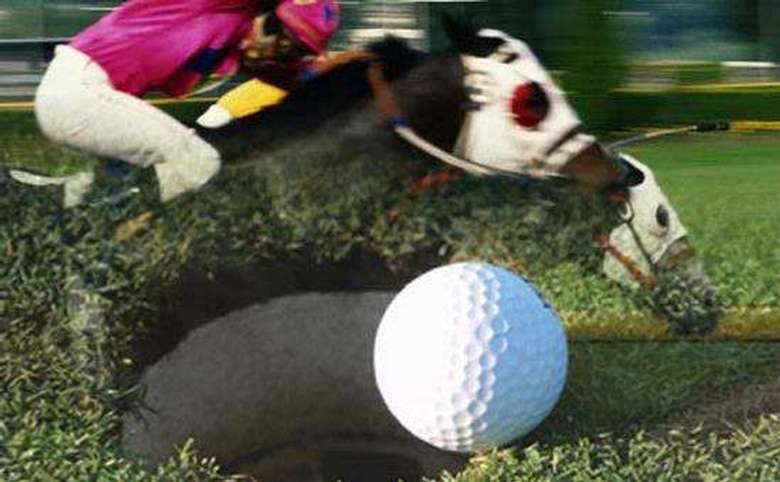 Horses racing in the background with a golf ball and cup in the foreground