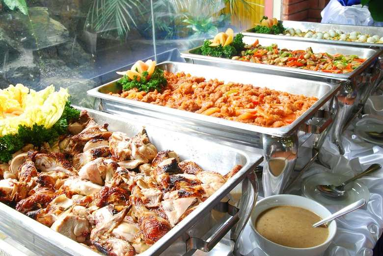 trays of food set up for an event