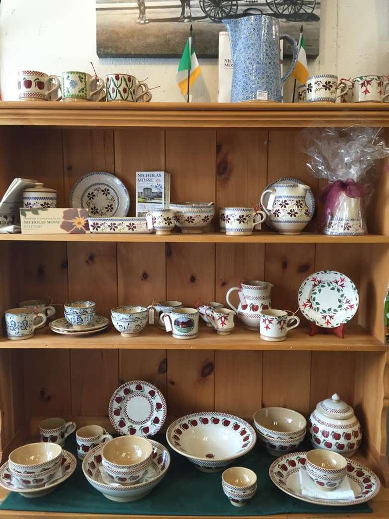 shelves full of ceramic dishes and drinkware