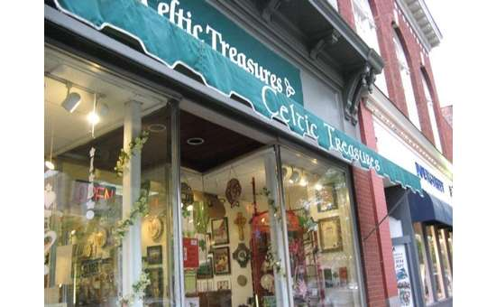 green awning on the exterior of celtic treasures