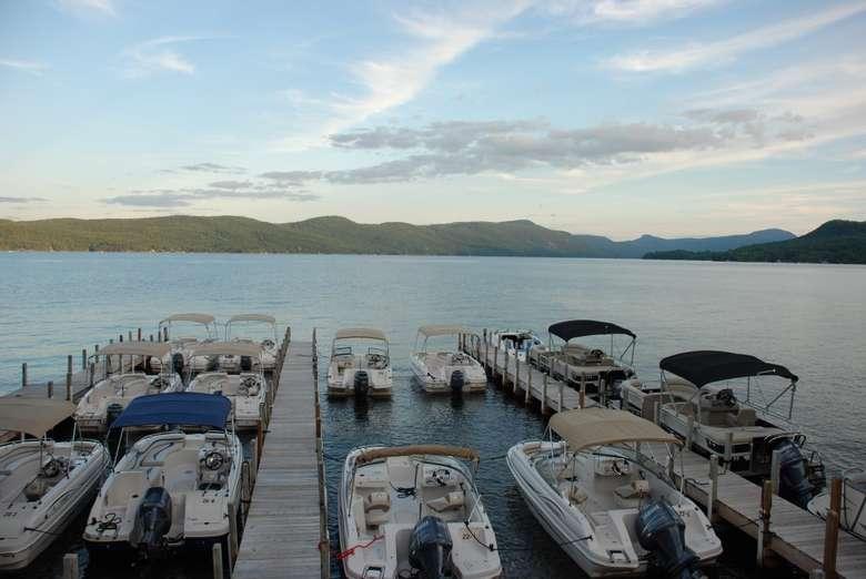 rows of boats alongside a few boat docks