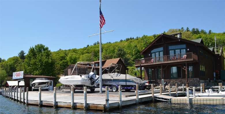 docks, boats, and a flag pole near a large brown building
