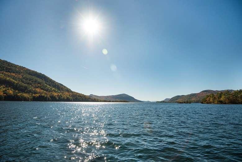 sun shining over lake george