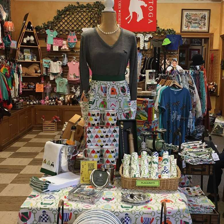 display of products like aprons and mugs with jockey designs on them