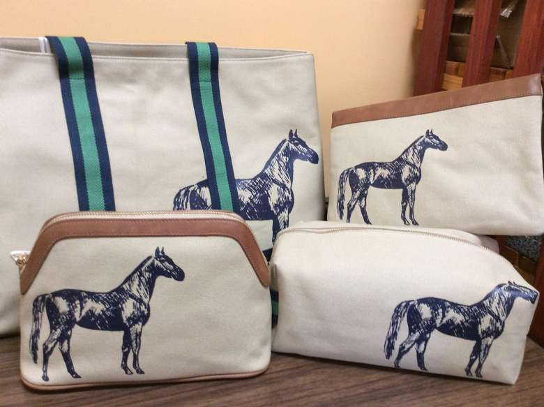 four canvas bags with horses on them