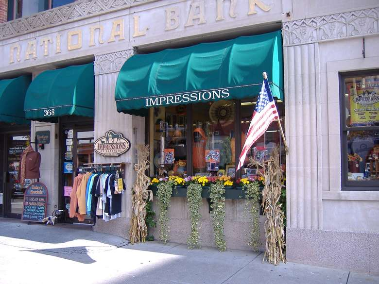 exterior of impressions of saratoga with a rack of clothes outside