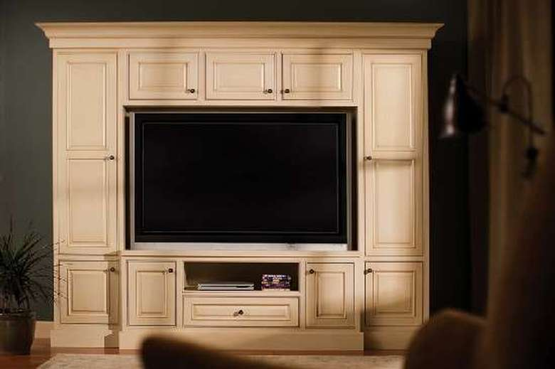 a tv within a large wall cabinet fixture