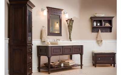 brown cabinet, table, and decor in a room
