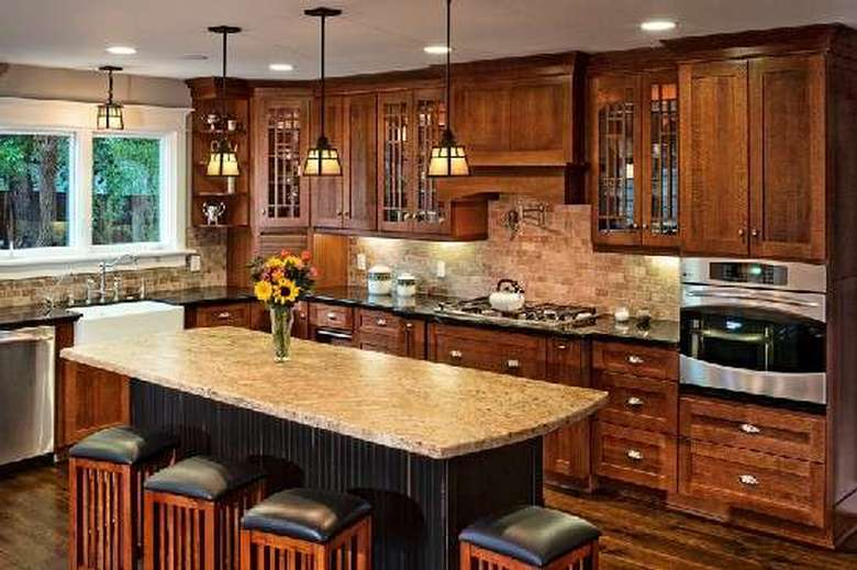 kitchen with a granite countertop on a table, and dark brown cabinets