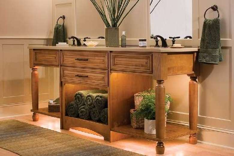 wooden cabinet with two sinks on top