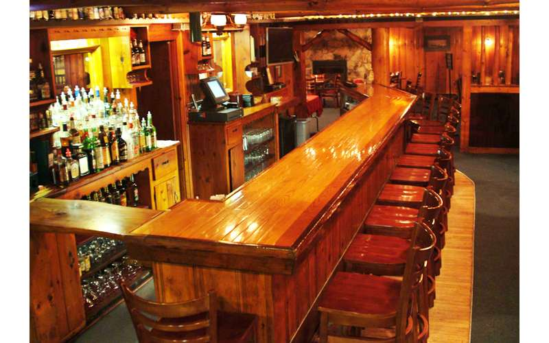 The Long Horn Restaurant & Pub features a cozy bar you're sure to love.