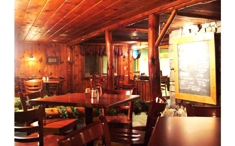 The main dining area has a rustic feel that is very comfortable and inviting.