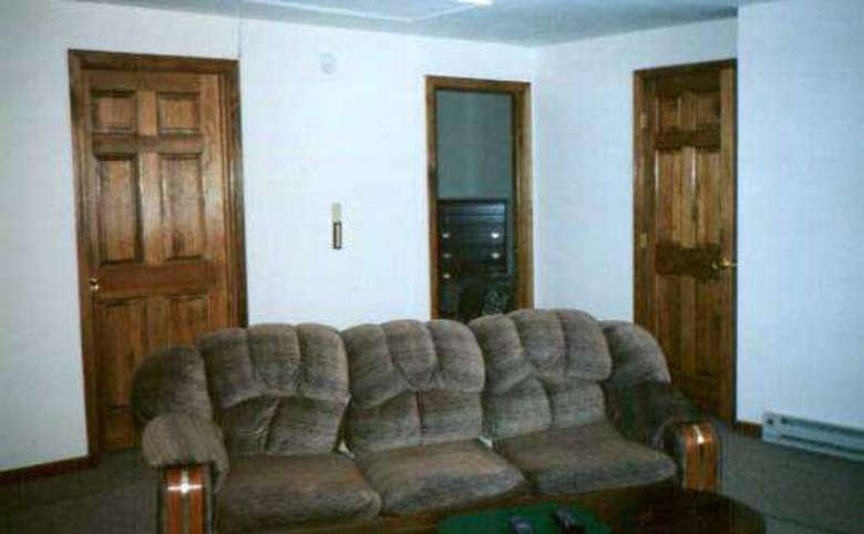 a couch in a living room with doors in the background