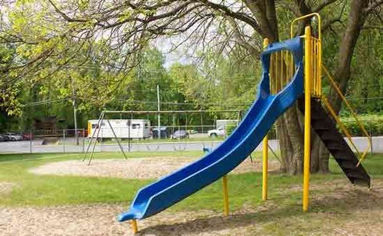 Slide with swings in the background