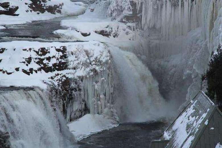 dramatic image of ausable river in winter