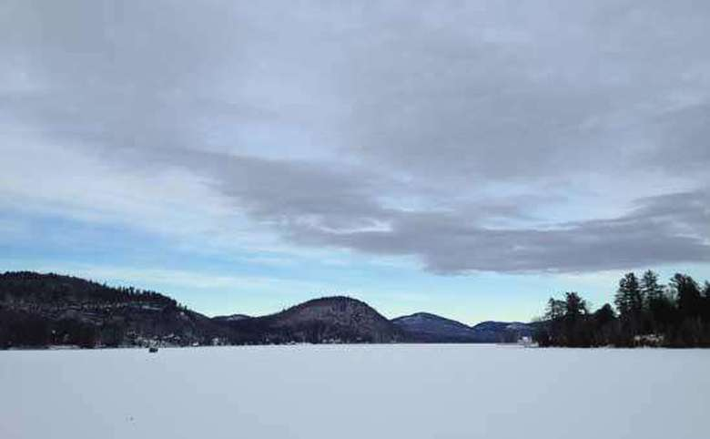 brant lake in winter covered in snow