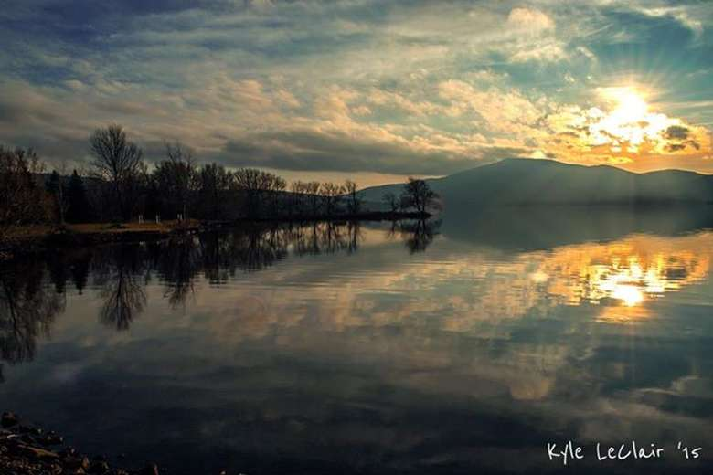 photography by kyle leclair of setting sun reflected off chazy lake