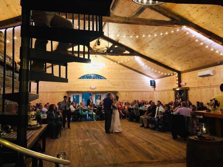 wedding dancers in a rustic barn