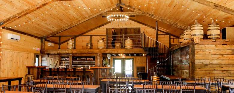 tables and bar in a rustic barn
