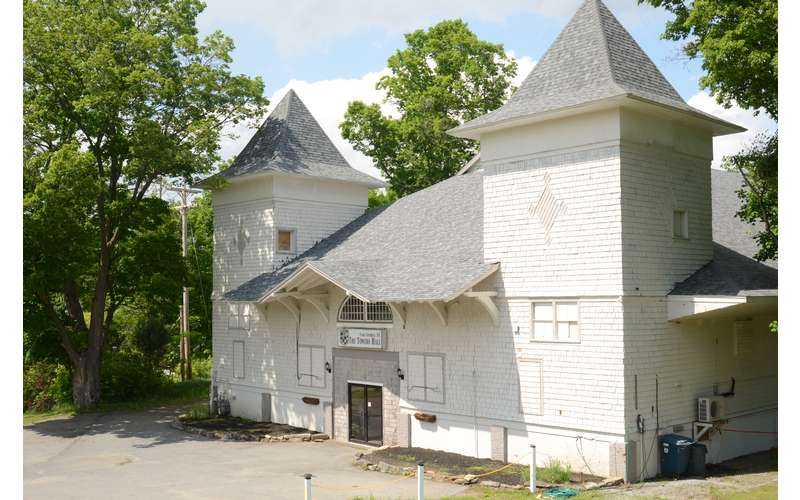 Towers Hall, a large historic carriage house with open floor space and tall ceiling.