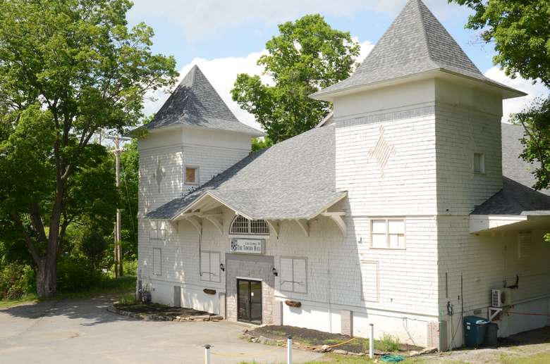 exterior of towers hall, a large historic carriage house