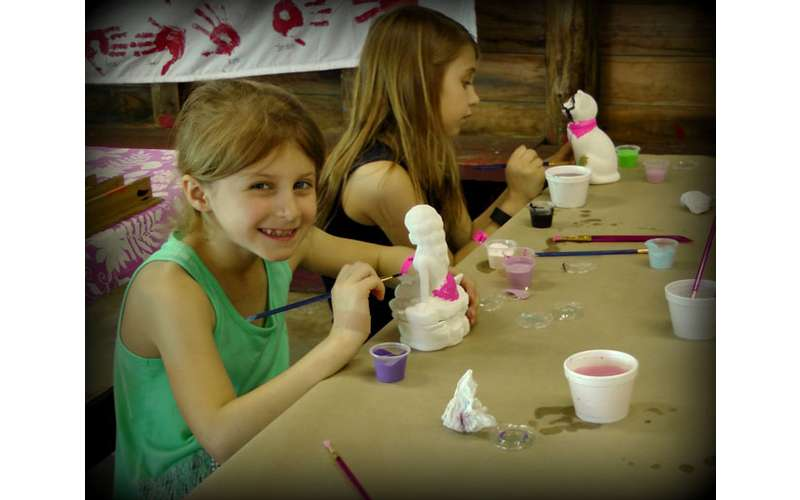 two little girls doing crafts