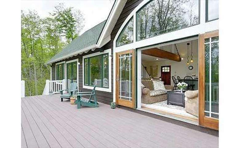 large deck with sliding doors leading into the house