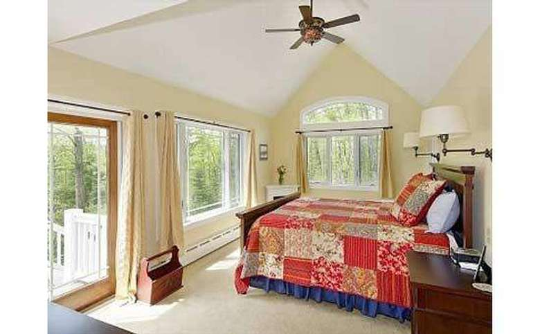 bedroom with a king-sized bed and vaulted ceilings