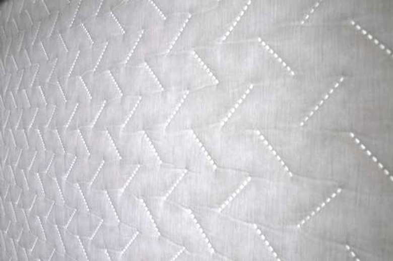 close-up of window quilt shades