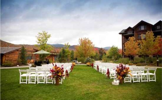 chairs set up for an outdoor wedding ceremony in the fall