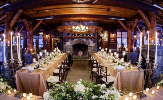 tables set up for a wedding reception in a rustic adirondack-style room