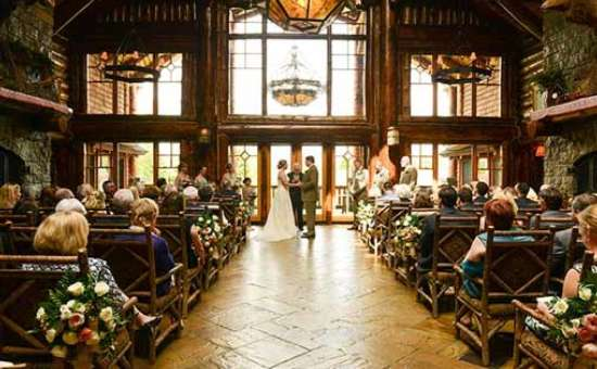 wedding ceremony inside an adirondack lodge-style great room