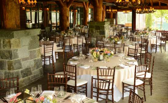 tables set up for a wedding reception in a rustic room