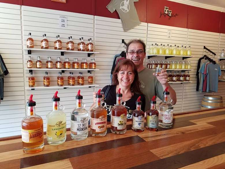 two customers at the distillery looking happy