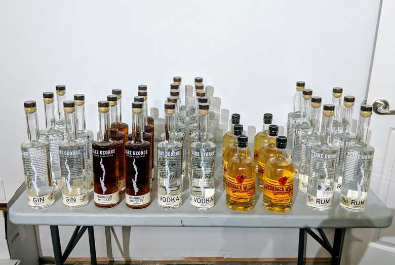 a table full of Lake George Distilling products