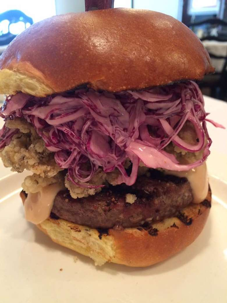 burger with slaw on top