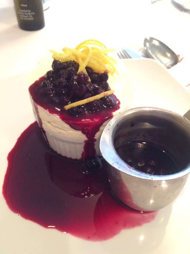 blueberry ice cream dessert with lemon zest on top