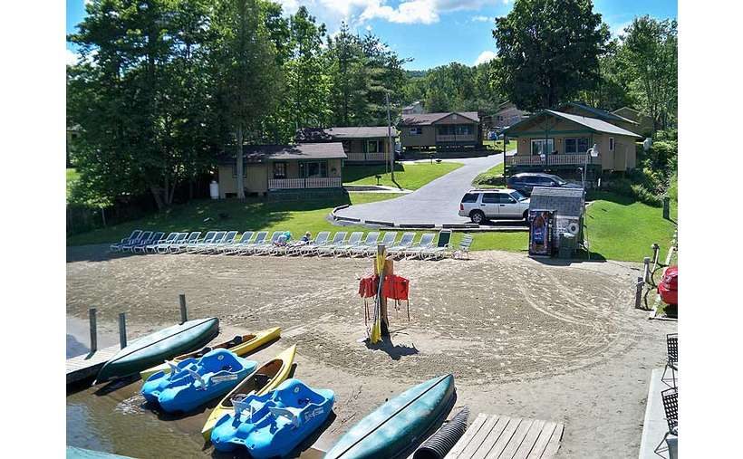 Sandy lakefront beach with free kayaks, paddleboats, canoes and rowboats for guests