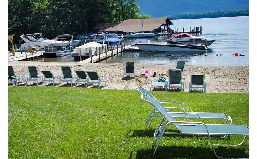 Lawn chairs and 221' sandy lakefront beach with boat launch available on site