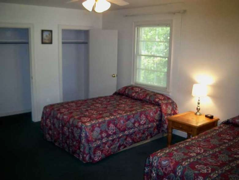 bedroom with two double beds and two closets