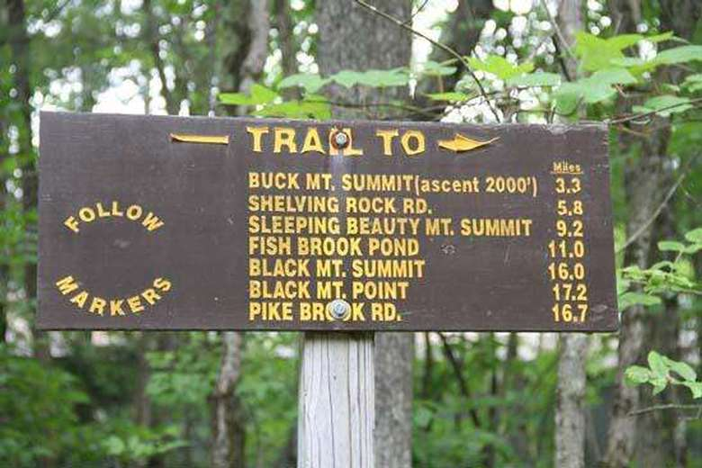 trail sign to buck mountain, shelving rock, and other trails