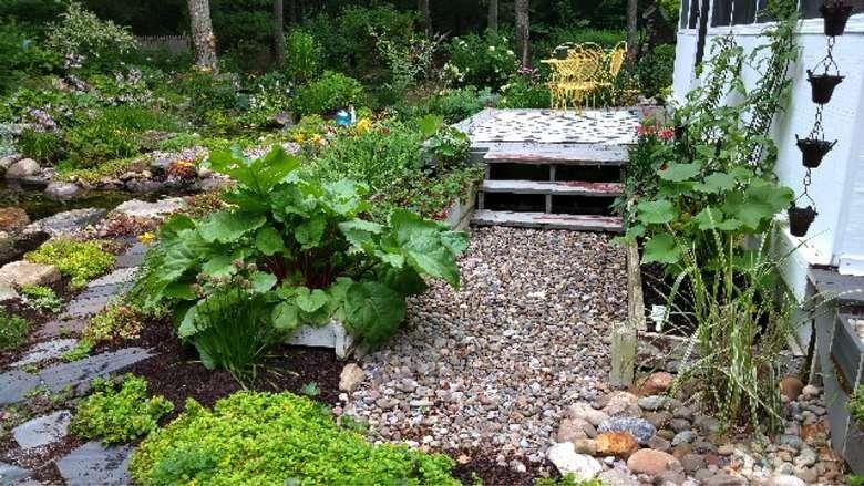 backyard garden with a patio seating area