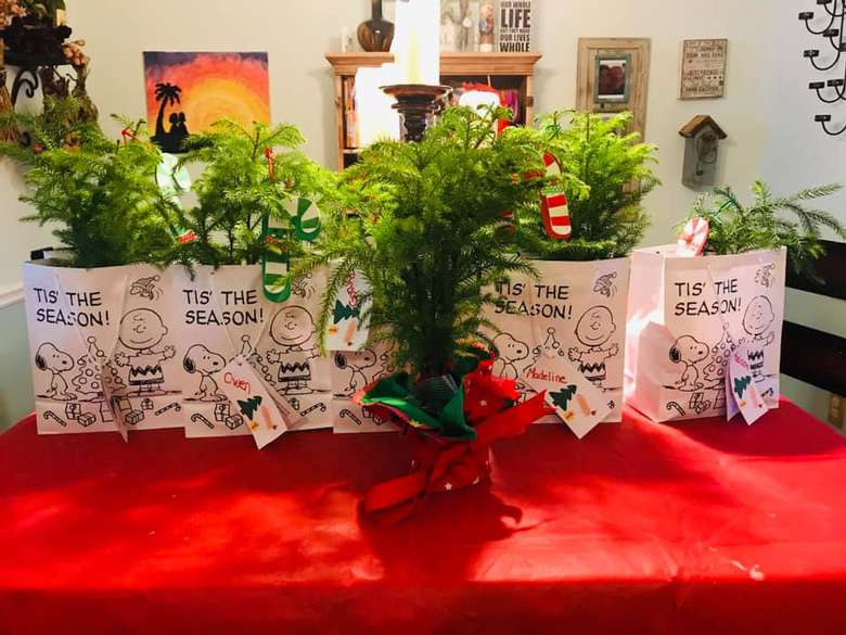 small trees in charlie brown gift bags