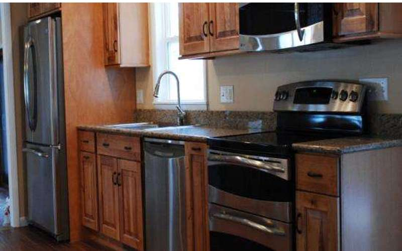 Allpro Restoration & Reconstruction restores the fire damaged kitchen to better than before!
