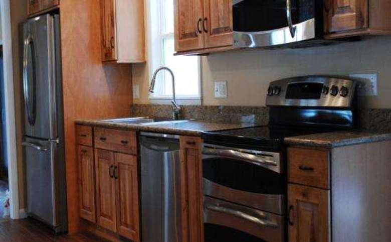 a newly remodeled kitchen after it was restored from fire damage