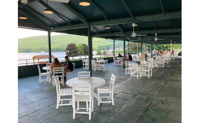 Covered Patio Dining view of the Lookout Cafe with fans over tables