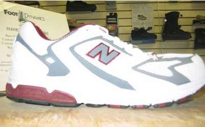 a white and gray new balance sneaker on display