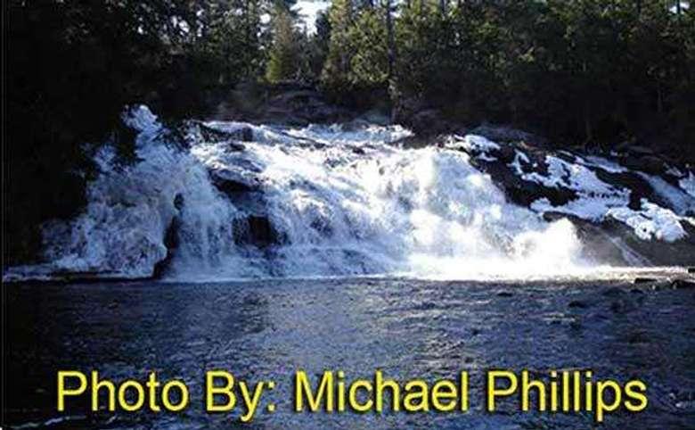 rushing waterfall in the spring